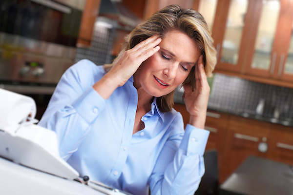 Woman having headache migraine.