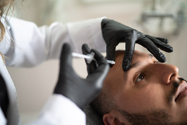 man receiving medical botox at spine options in white plains new york